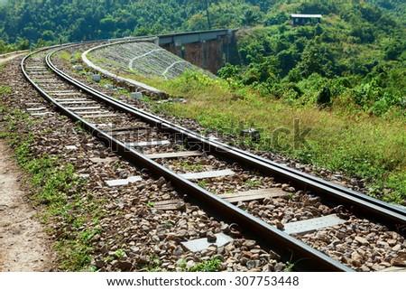 Arch railroad tracks - stock photo