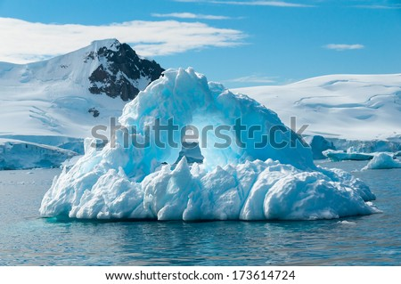 Arch shaped iceberg Antarctica - stock photo