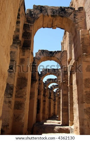 Arch shaped walkways of the Coliseum of Thysdrus at El Jem, Tunisia - stock photo