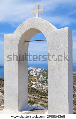 Arch with cross in the landscape of Santorini, Greece - stock photo
