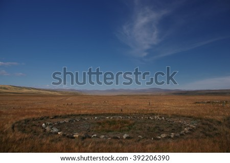 Archaeological excavations on the site of ancient Scythian burials of Pazyryk culture on the river Ak-Alakha, where was found the mummy of a shaman. Plateau Ukok, Altai Mountains, Siberia, Russia - stock photo