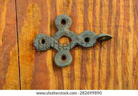 archaeological find.  ancient Celtic pendant - stock photo