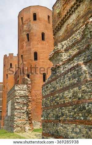 Archaeological Park with Palatine towers (Porte Palatine), ancient Roman city gates of Turin, Italy. Ruins of ancient theater. - stock photo