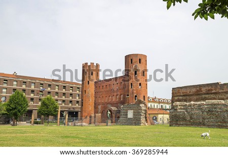 Archaeological Park with Palatine towers (Porte Palatine), ancient Roman city gates of Turin, Italy.Ruins of the ancient theater. - stock photo