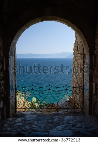 arched balcony of fortresse Acronafplia on the sea of Nauplion - stock photo