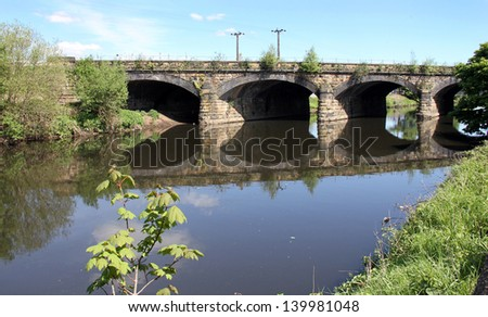 Arched bridge over a river. Taken near Dewsbury West Yorkshire UK