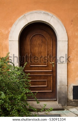 Arched doors and shrubs - stock photo