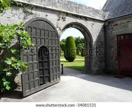 Arched gate and doorway at Lanhydrock Castle near Bodmin in Cornwall, England - stock photo