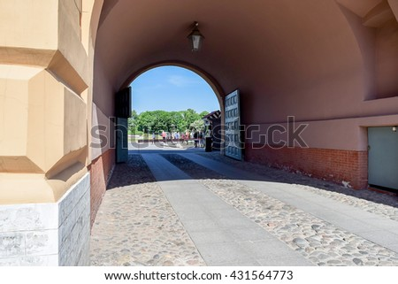 Arched gate with paved road of Peter and Paul fortress in St. Petersburg, Russia