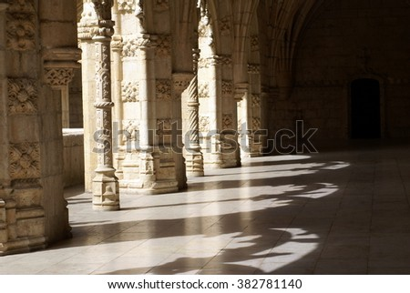 Arched opening in the first floor arcade in the cloister of the Jeronimos Monastery, leaving filigreed shadows on the floor