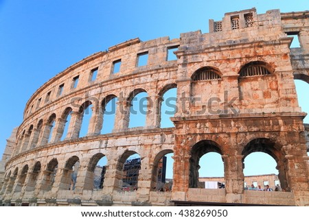 Arched ruins of a Roman amphitheater in Pula, Croatia - stock photo