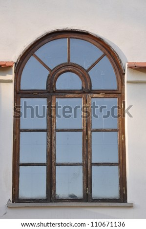 Arched window on the wall of the castle