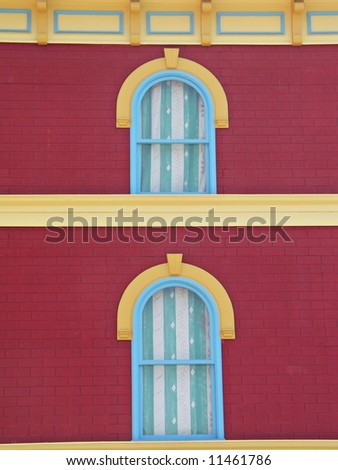 Arched windows on a red wall