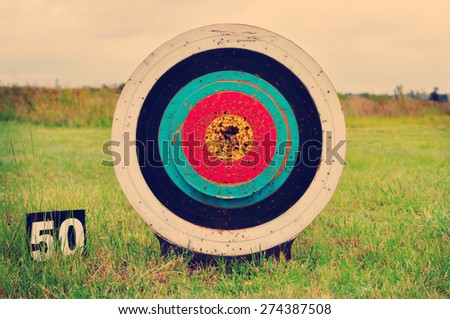 Archery target on the field - stock photo