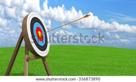 Archery target with an arrow stuck accurately in the center ring bullseye - stock photo