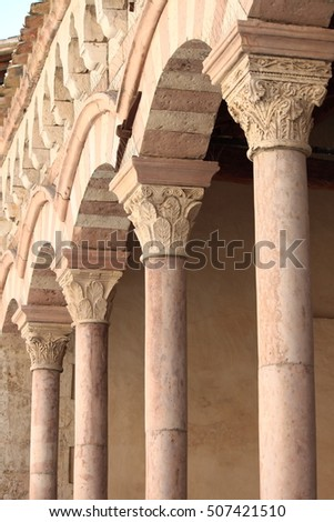 Arches in a medieval colonnade of a cloister