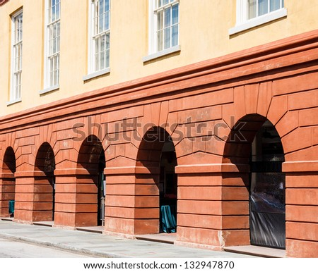 Arches in red stone exterior wall