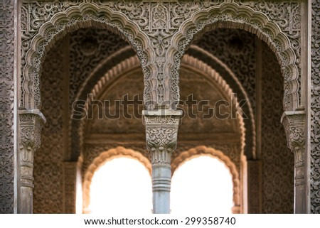 Arches in the Alhambra Palace near Granada, Spain - stock photo