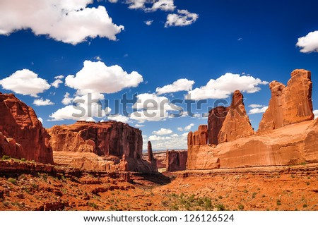 Arches National Park landscape view with blue sky and white clouds, Utah, USA - stock photo