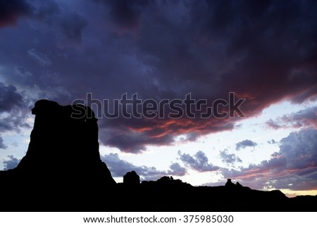 Arches National Park near Courthouse Towersand Courthouse Wash.  An alpenglow sunset.  Moab, Utah is next to both Canyonlands and Arches National Parks as well as Dead Horse Point State Park.  - stock photo