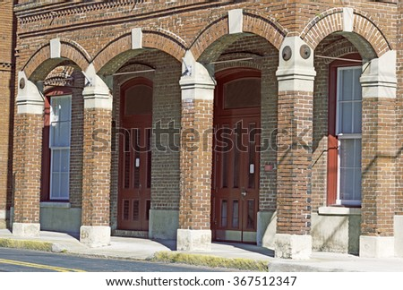 Arches of historic brick building in Tampa, FL