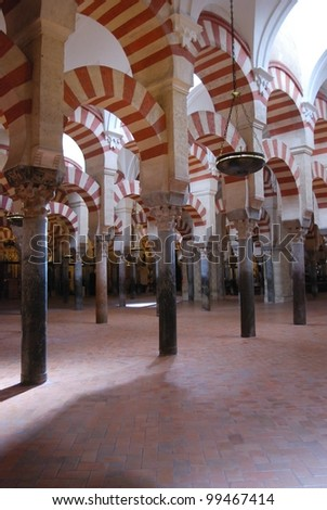 Arches within the Prayer Hall of the Mezquita (Mosque), Cordoba, Cordoba Province, Andalusia, Spain, Western Europe. - stock photo