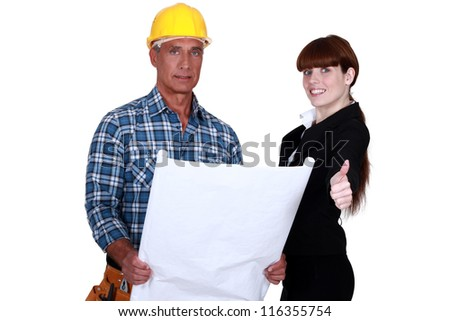 Architect and builder discussing plans - stock photo