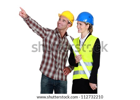 Architect and builder pointing into blank copyspace - stock photo