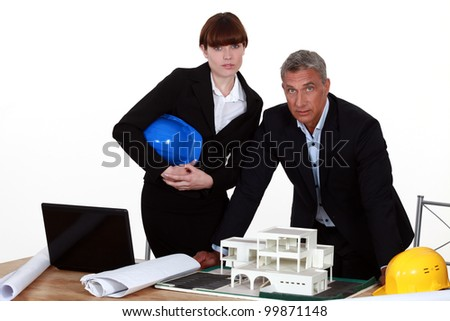Architect and colleagues preparing business proposal - stock photo