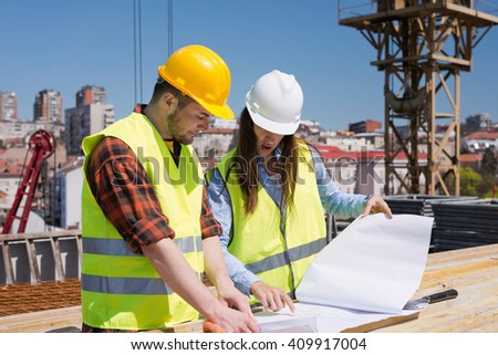 Architect and construction worker on site