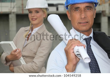 Architect and female assistant - stock photo