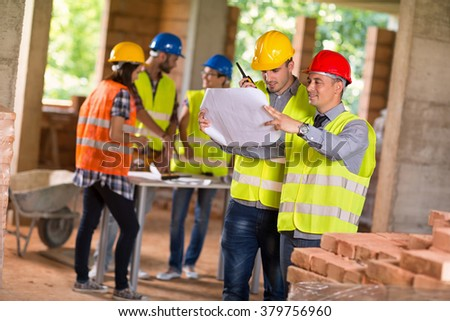 Architect and investiture of construction consider possibilities at  construction site  - stock photo
