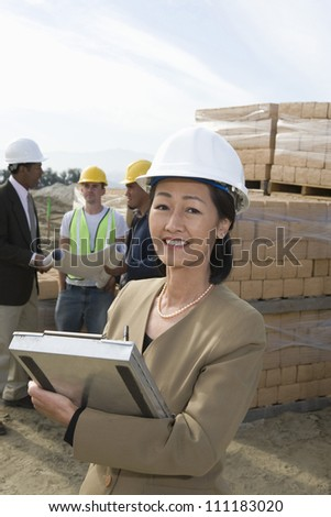 Architect at construction site - stock photo