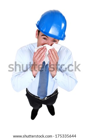 Architect blowing his nose - stock photo