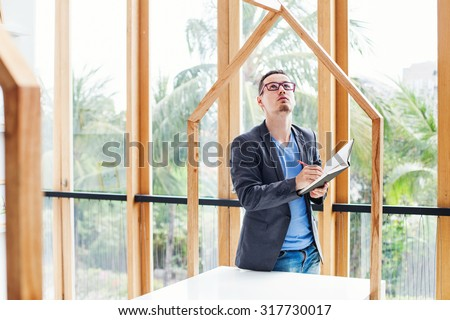 architect checking the quality of house model