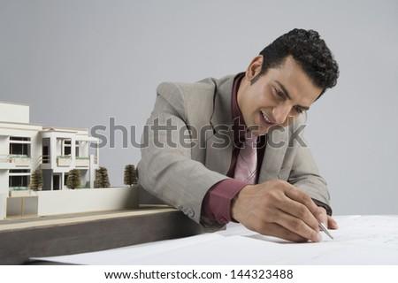 Architect designing a blueprint - stock photo