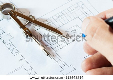 Architect drawing a construction project - stock photo