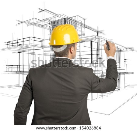 Architect drawing a futuristic sketch on a virual screen - stock photo