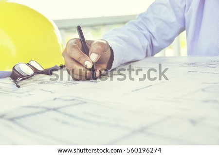 Architect drawing on architectural project business, architecture, building, construction and people concept - close up of architect hands with compass measuring living house blueprint