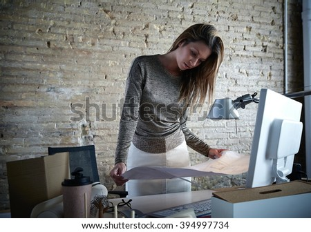 Architect engineer woman working with plan at office indoor - stock photo