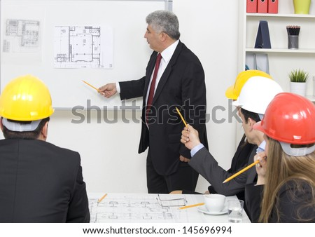 architect giving presentation to a small business group.