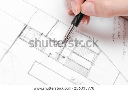 Architect Hand Drawing House Plan Sketch With Pencil - stock photo