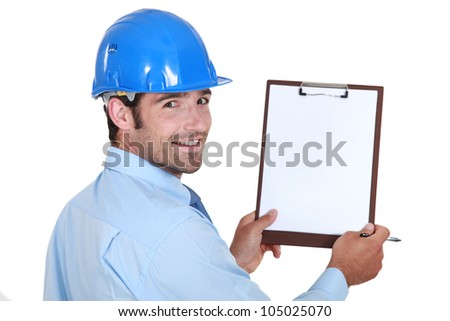 Architect holding clip-board and pen - stock photo