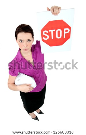 Architect holding stop sign - stock photo