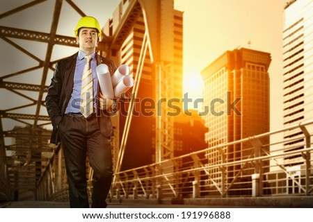 Architect in protective helmet  - stock photo