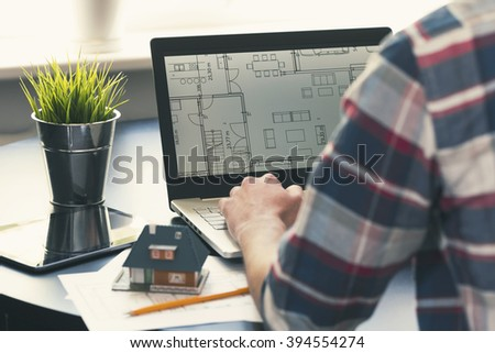 architect, interior designer occupation - man working on new house project at office - stock photo