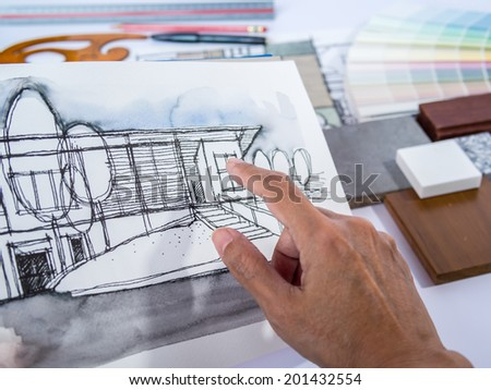 Architect /interior's hand working with illustration of home renovation project concept - stock photo