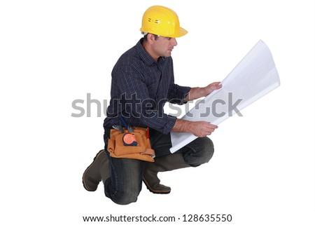 Architect kneeling - stock photo