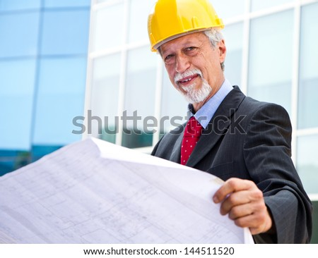 Architect Looking At Blueprint - stock photo