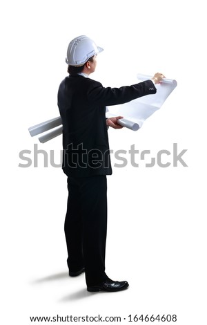 Architect looking at blueprints, Isolated over white with clipping path - stock photo